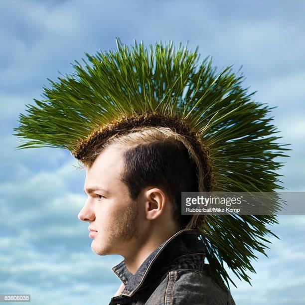 man with a grass mohawk