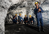 Man with a group of miners