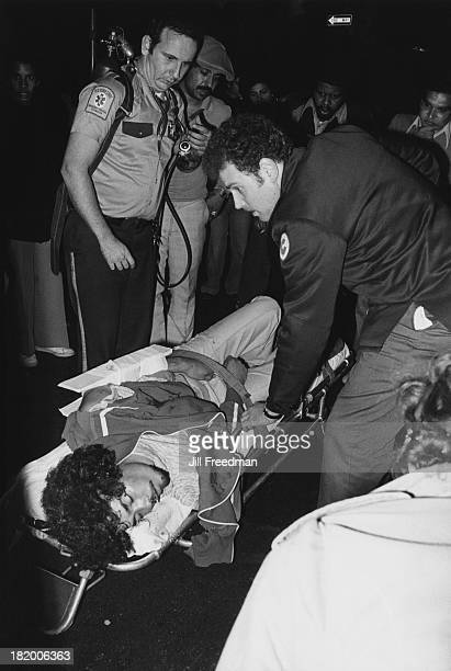 A man with a gun shot to the stomach is loaded into an ambulance by two paramedics in New York City 1978