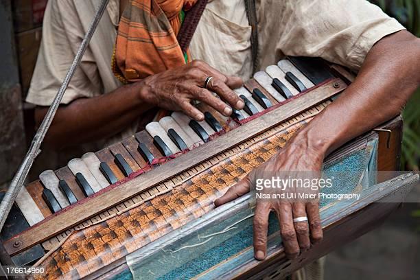Man with a 'home-made' harmonium in Kolkata, India