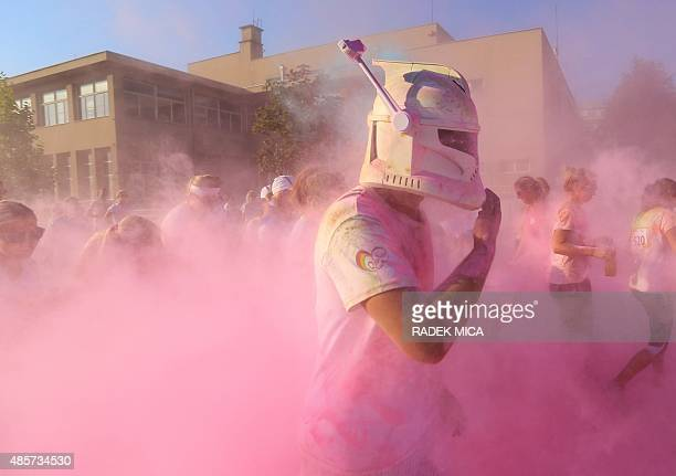 A man with a mask takes part in a rainbow run in Brno Czech Republic on August 29 2015 People taking part in the 5km charity run throw colours during...