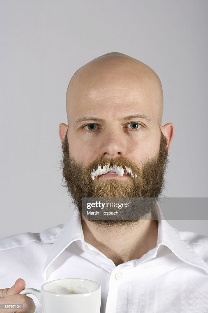 A man with a milk moustache on his real mustache