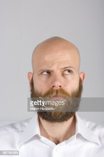 A man with a noodle in his beard