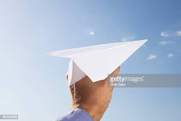 man with a paper airplane
