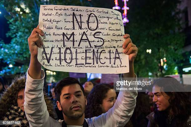 A man with a placard that reads 'No more violence' protesting against genderbased violence during the International Day for the Elimination of...