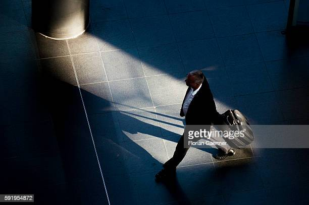 A man with a suitcase goes through the central station on August 19 2016 in Berlin Germany