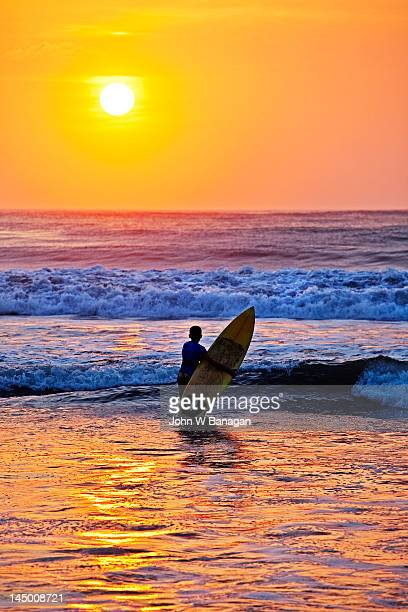 Man with a surfboard, Kuta beach,  Bali