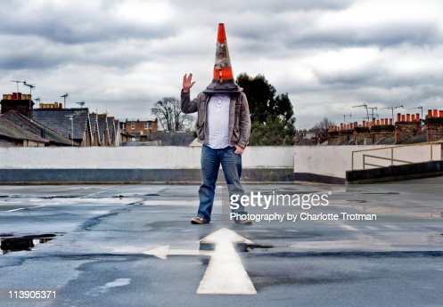 Man with a traffic cone on his head