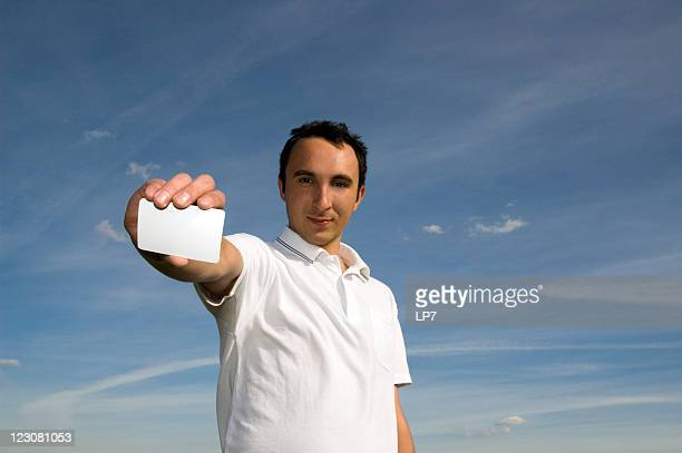 Man with a white card