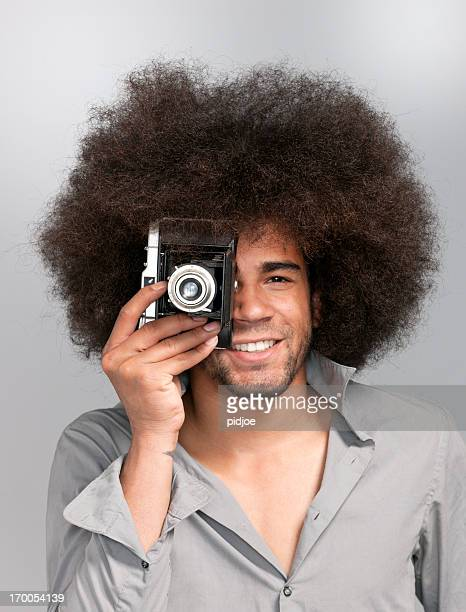 man with afro hair taking picture, XXXL image