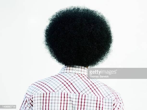 Man with afro hairstyle rear view