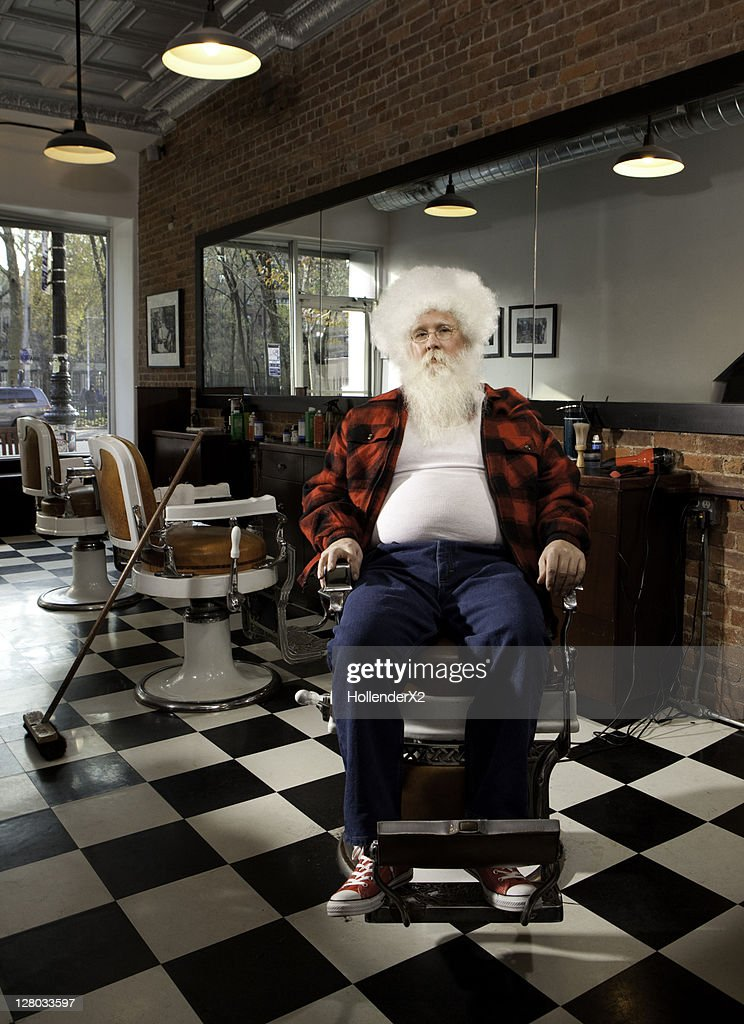 Man with afro in barbarshop : Stock Photo
