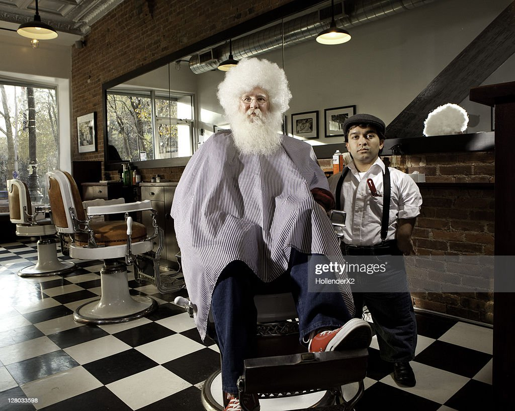 Man with afro with barber : Stock Photo