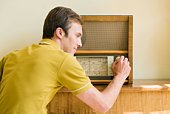 Man with antique radio