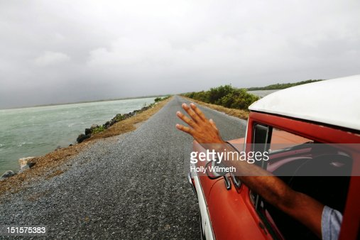 Man with arm out car window : Stock Photo