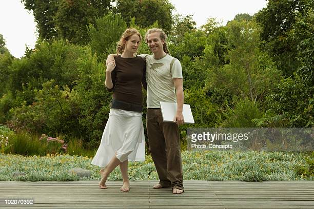 Man with arms around woman
