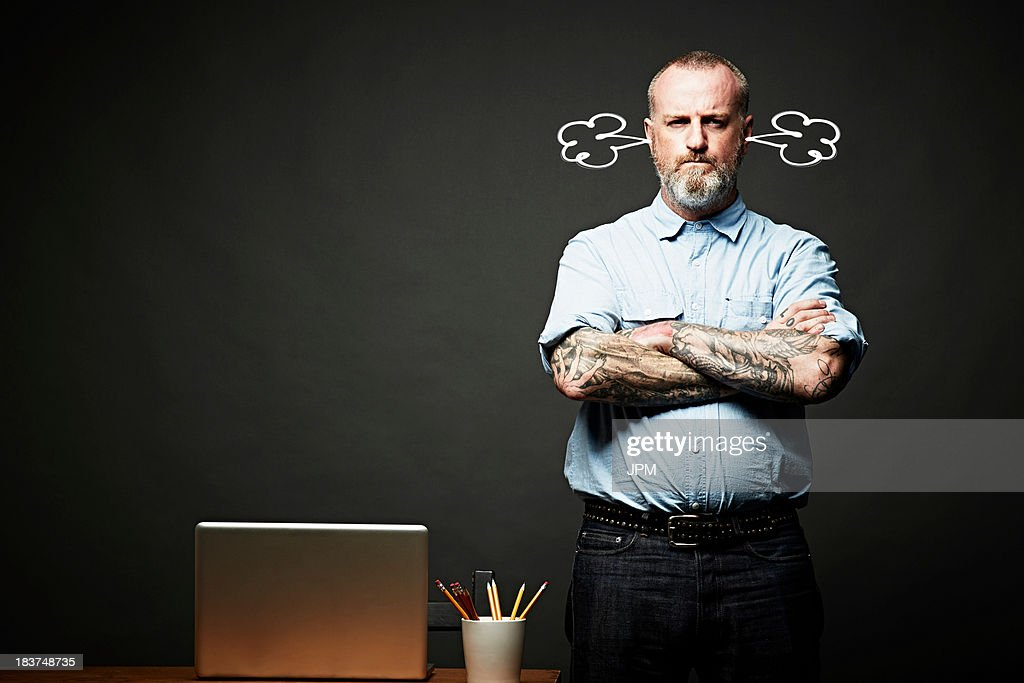 Man with arms crossed fuming in silence