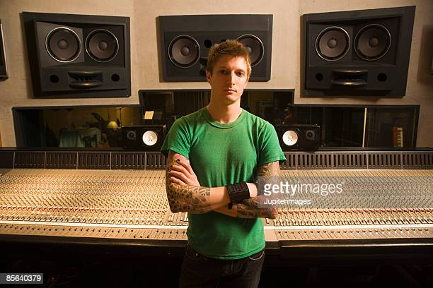 Man with arms crossed in recording studio