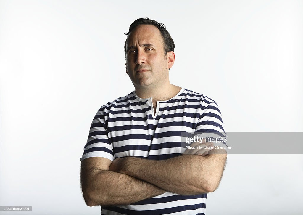 Man with arms crossed, portrait