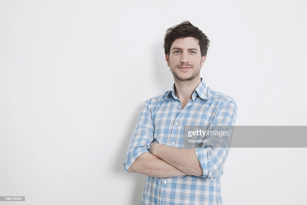 Portrait of happy mid adult man on white background