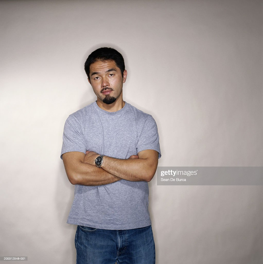Man with arms folded, portrait : Stock Photo