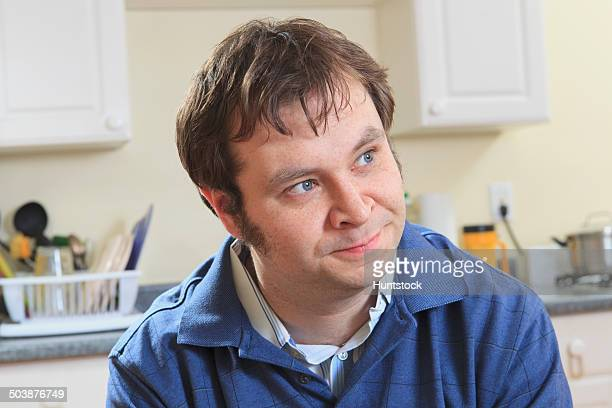 Man with Aspergers in his home living independently
