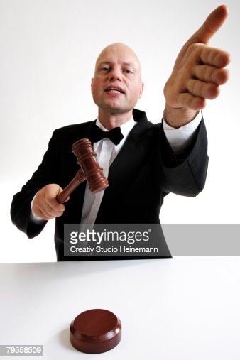 Man with auctioneer's hammer