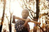 Man with axe in the forest