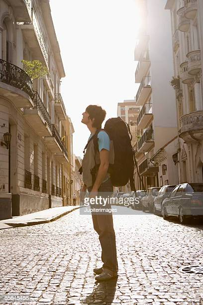 Man with backpack in street