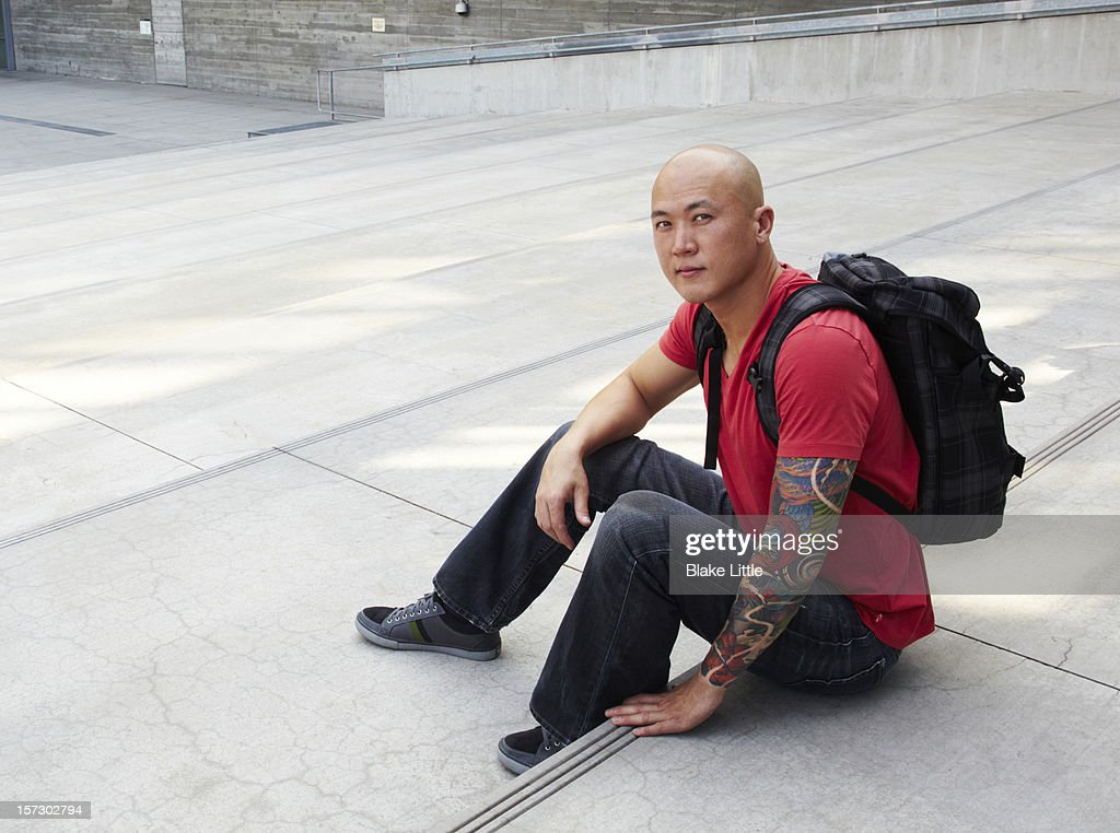 Man with backpack on steps. : Stock Photo