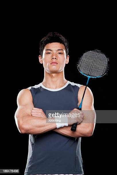 Man with badminton racket, portrait