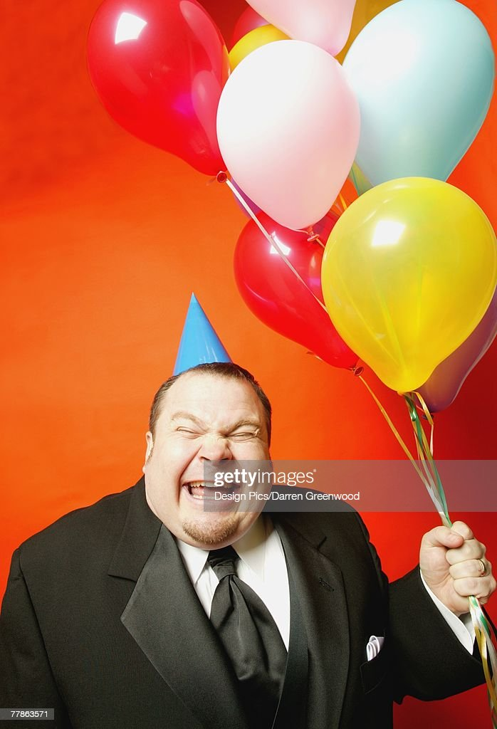 A man with balloons : Stock Photo