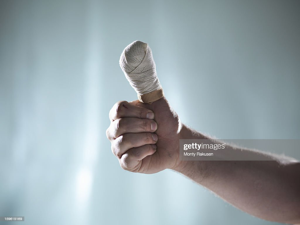Man with bandaged thumb