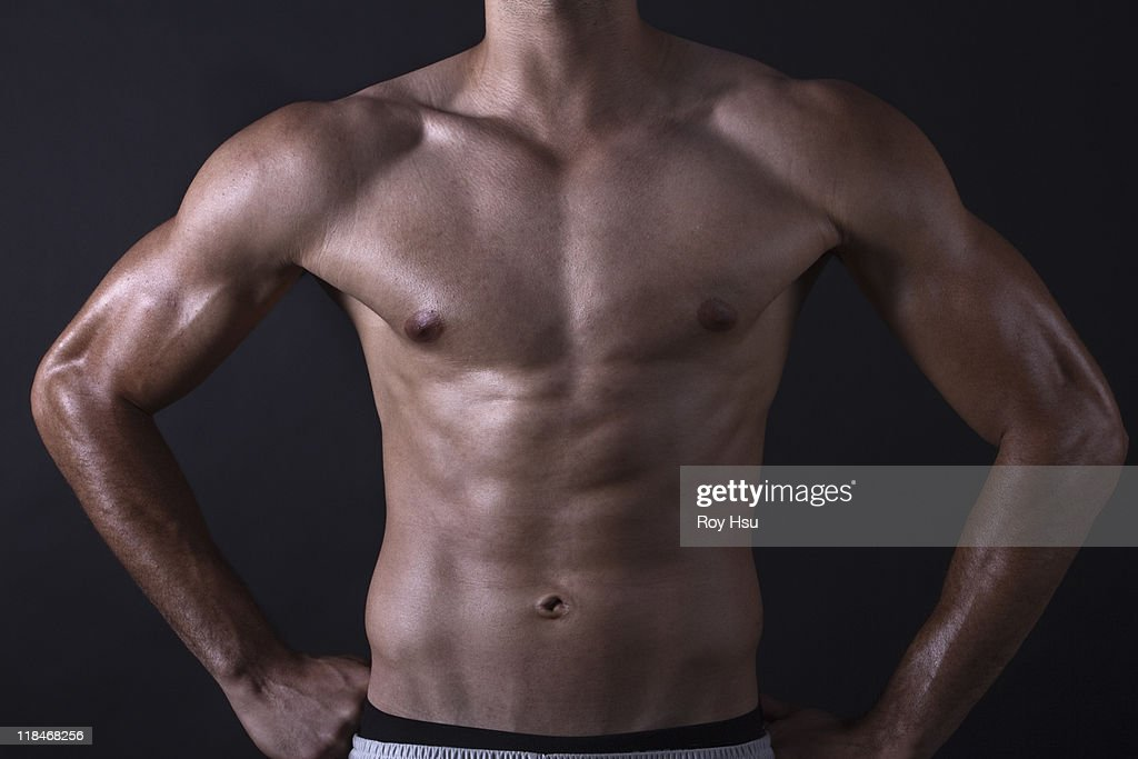 Man with bare stomach : Stock Photo