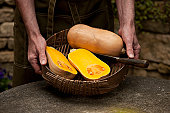 Man with basket of butternut squash