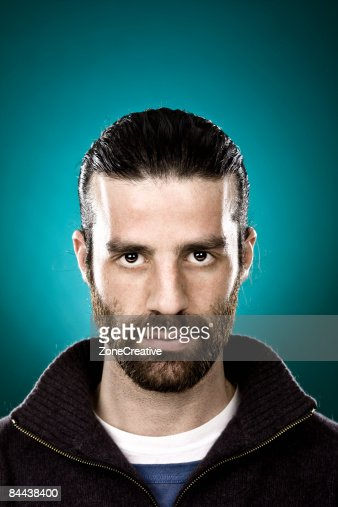man with beard and black hair portrait : Foto de stock