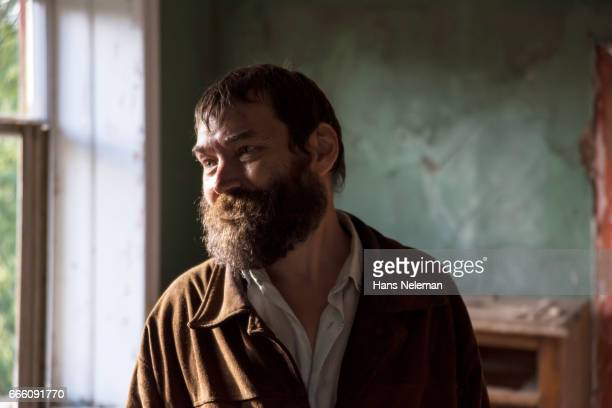 Man with beard in old house