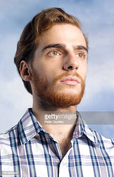 Man with beard looking into sky