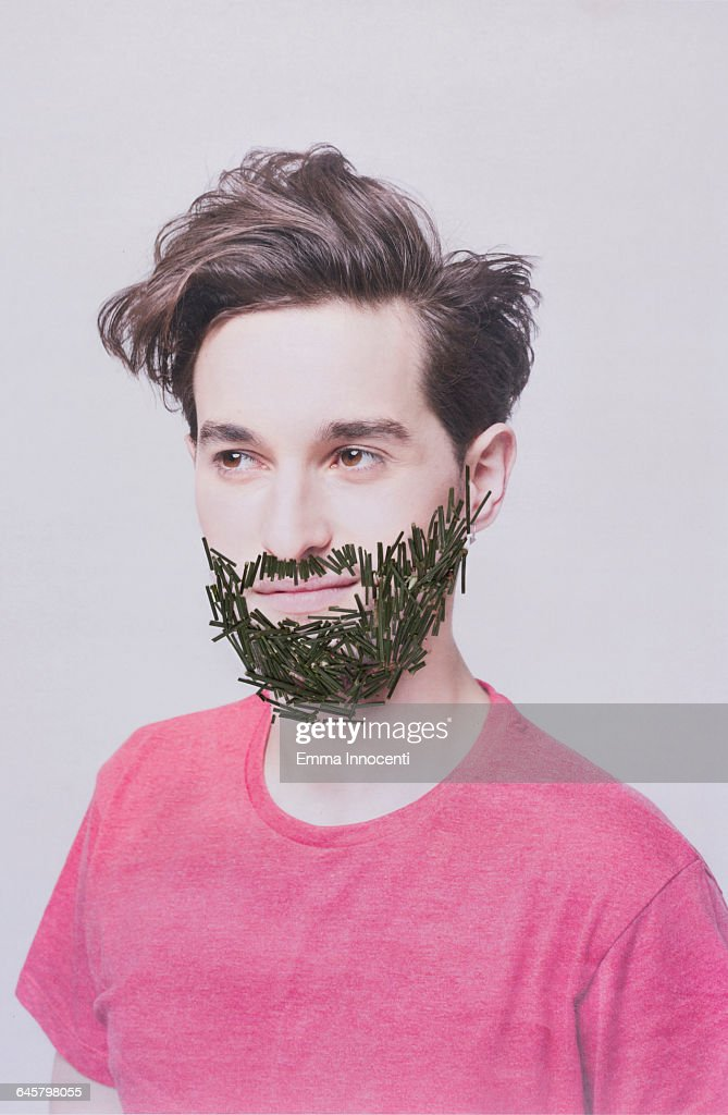 Man with beard made of grass