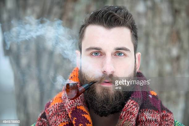 Man with Beard puffing away at his Pipe