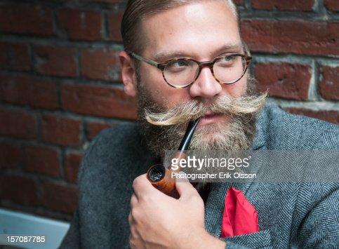 Man with beard smoking pipe