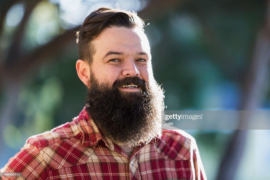Man with beard wearing plaid shirt : Stock Photo
