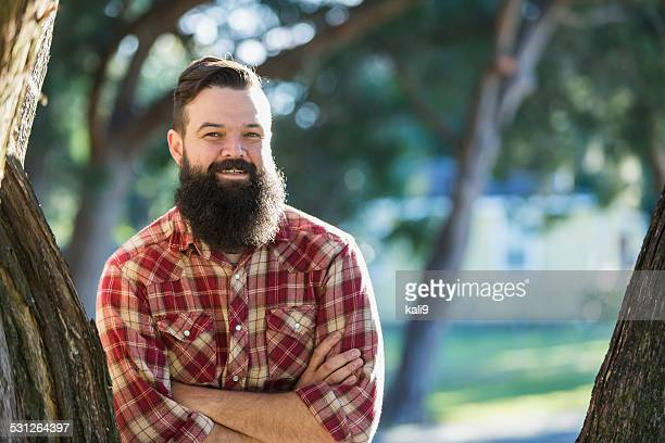 Man with beard wearing plaid shirt