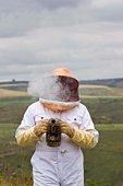 Man with bee smoker