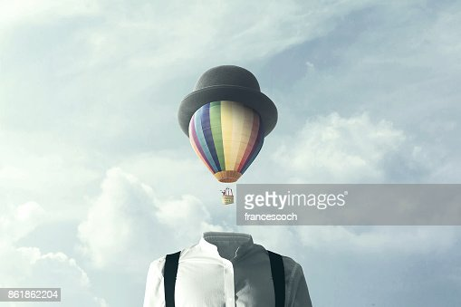 man with big balloon fly on his head, changement concept : Stock Photo