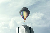 man with big balloon fly on his head, changement concept