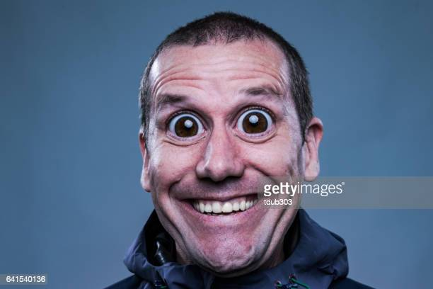 Man with big eyes looking very happy and surprised
