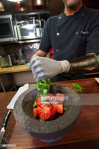 Man with bionic prosthetic hand preparing food.