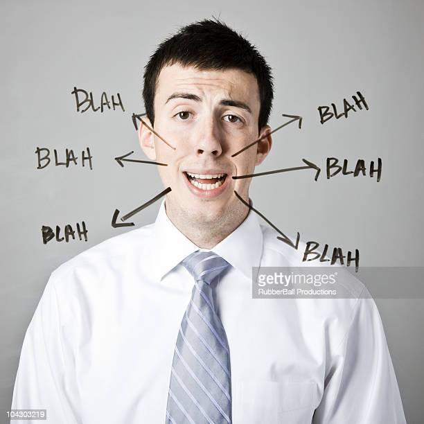 man with blah blah blah written around his face