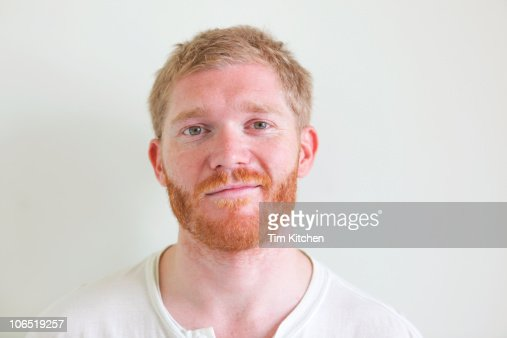 Man with blond hair and red beard, smiling : Stock Photo